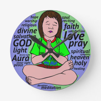 Small girl praying and meditating,sitting on earth round clock