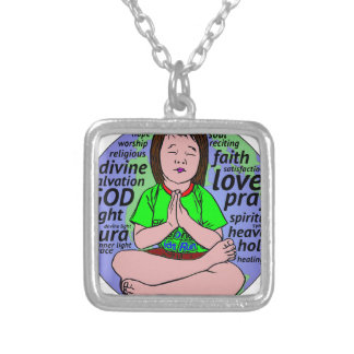 Small girl praying and meditating,sitting on earth silver plated necklace