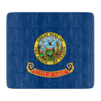 Small glass cutting board with flag of Idaho