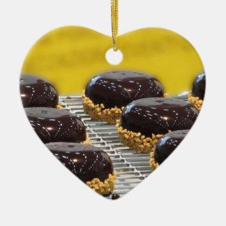 Small glazed chocolate cakes with hazelnut grains ceramic ornament
