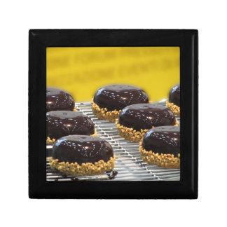Small glazed chocolate cakes with hazelnut grains gift box