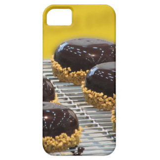 Small glazed chocolate cakes with hazelnut grains iPhone 5 case