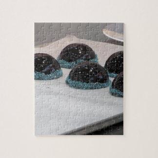Small glazed chocolate cakes with hazelnut grains jigsaw puzzle