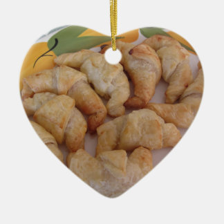 Small homemade salty croissants with sausage ceramic heart ornament