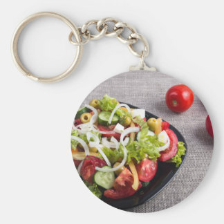 Small plate of natural salad of raw vegetables basic round button keychain