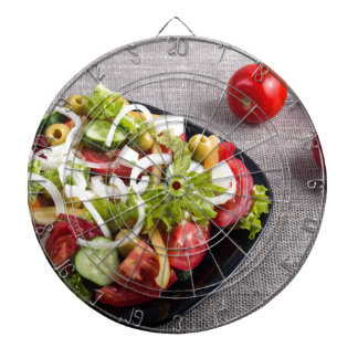 Small plate of natural salad of raw vegetables dartboard