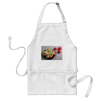 Small plate of natural salad of raw vegetables standard apron