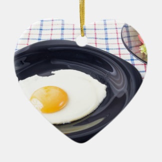 Small portion of the breakfast of fried egg ceramic heart ornament