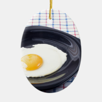 Small portion of the breakfast of fried egg ceramic oval ornament