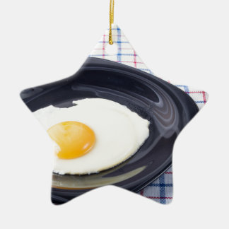 Small portion of the breakfast of fried egg ceramic star ornament