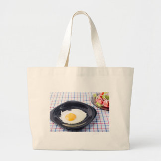 Small portion of the breakfast of fried egg large tote bag