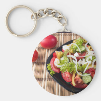 Small portion of vegetable salad of tomato basic round button keychain