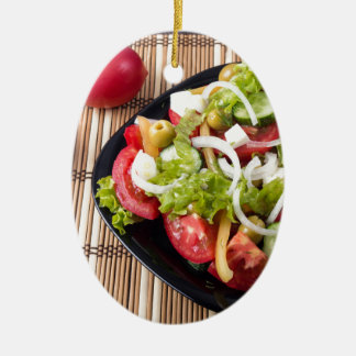 Small portion of vegetable salad of tomato ceramic oval ornament
