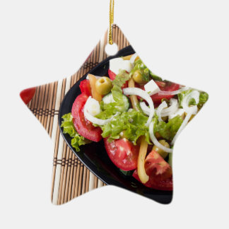 Small portion of vegetable salad of tomato ceramic star ornament