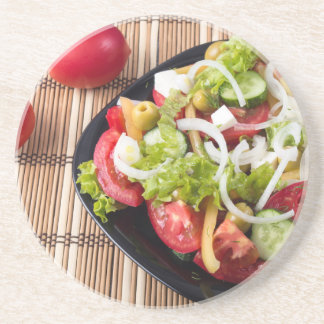Small portion of vegetable salad of tomato coaster