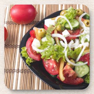 Small portion of vegetable salad of tomato drink coaster