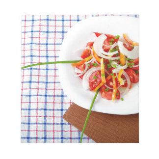 small portion of vegetarian salad notepad