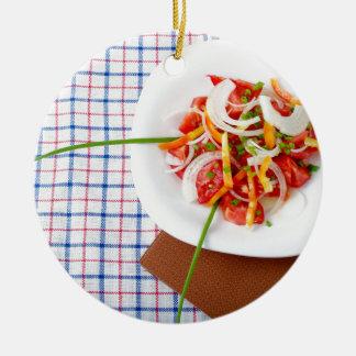 small portion of vegetarian salad round ceramic ornament