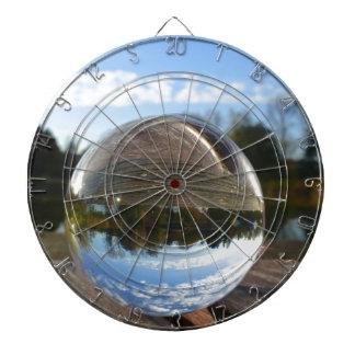 Small sea seen through a crystal ball dart board