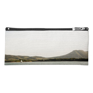 Small ship sailing on a lake at the afternoon pencil case