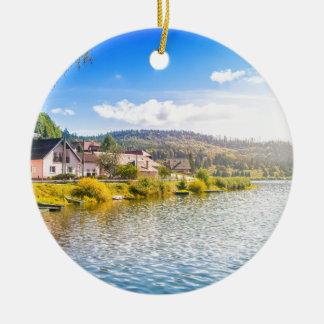 Small village near a lake ceramic ornament