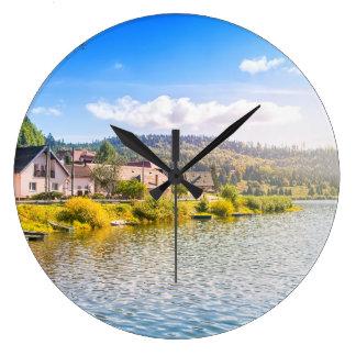 Small village near a lake large clock