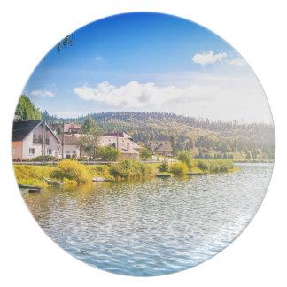 Small village near a lake plate