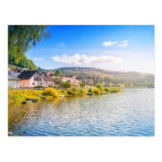 Small village near a lake postcard