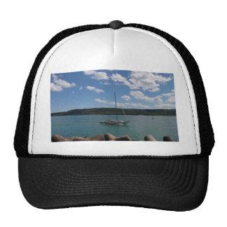 Small Yacht Returning To Port Trucker Hat