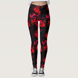 Smaller bright red blossoms on black leggings