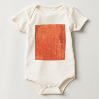 smear of orange baby bodysuit
