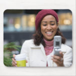 Smiling Business Woman with Cell Phone Mousepads