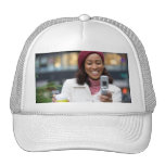 Smiling Business Woman with Cell Phone Trucker Hat