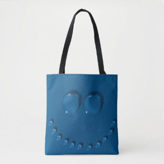 Smiling face made of waterdrops on a blue tote bag