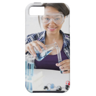 Smiling mixed race teenage girl conducting iPhone 5 cases