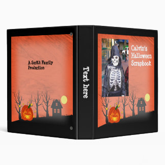 Smiling pumpkin in front of a haunted house binder