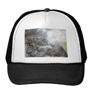 Smoking burning charcoal on barbecue trucker hat