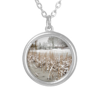 Snow and ice on water of pond silver plated necklace
