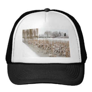Snow and ice on water of pond trucker hat