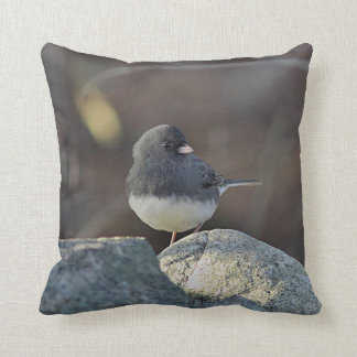 Snow bird on stone wall throw pillow