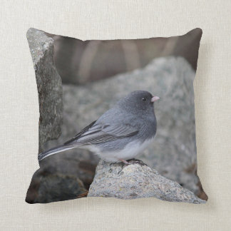 Snow bird perched on a stone wall throw pillow