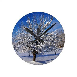 Snow covered Apple tree Clocks