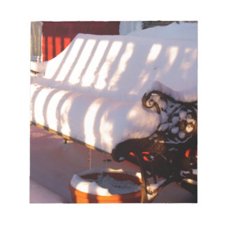 Snow covered bench notepad