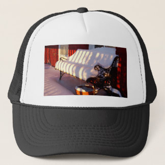 Snow covered bench trucker hat