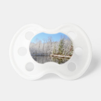 Snow covered landscape around the pond baby pacifiers