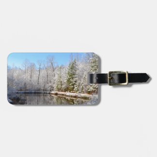 Snow covered landscape around the pond bag tag