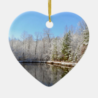 Snow covered landscape around the pond ceramic heart ornament