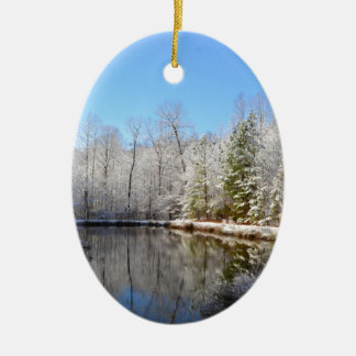 Snow covered landscape around the pond ceramic oval ornament
