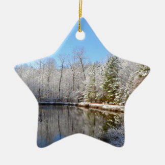Snow covered landscape around the pond ceramic star ornament