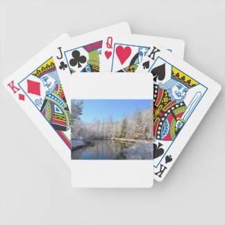 Snow covered landscape around the pond poker deck